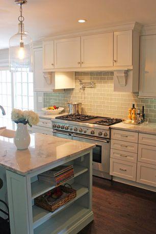 Traditional Kitchen with Flat panel cabinets, Pendant light, One-wall, Breakfast bar, Kitchen island, Hardwood floors, Flush
