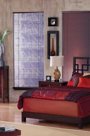 Modern Guest Bedroom with Laminate floors, interior wallpaper