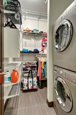 Contemporary Laundry Room with High ceiling, Built-in bookshelf, Concrete tile , drop-in sink, Hanging Bar, Wainscotting