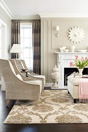 Traditional Living Room with Hardwood floors, Crown molding, Cement fireplace