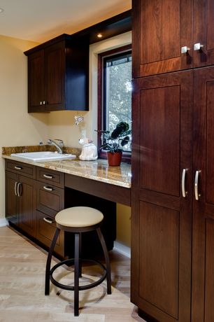 Modern Laundry Room with Built-in bookshelf, can lights, laundry sink, drop-in sink, specialty window, Hardwood floors