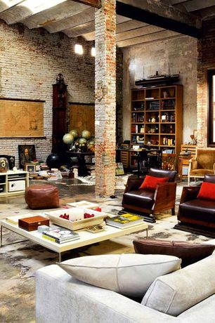 Contemporary Living Room with Wall sconce, Columns, Exposed beam, Greta coffee table, interior brick, Concrete floors