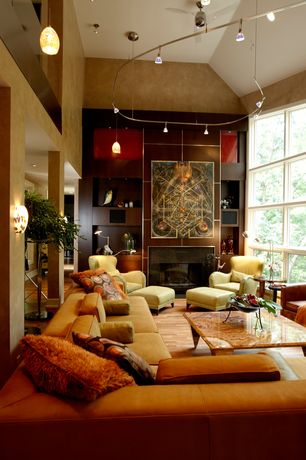 Modern Living Room with Wall sconce, Columns, picture window, can lights, flush light, stone fireplace, Ceiling fan, Loft