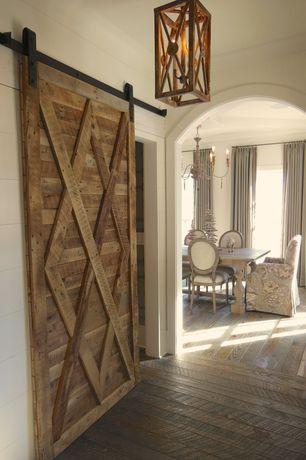 Country Hallway with Arch doorway, Barn door, Upholstered dining chair, Paint, Standard height, Crown molding, Chandelier