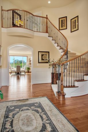 Traditional Entryway with Balcony, Wainscotting, Hardwood floors, High ceiling
