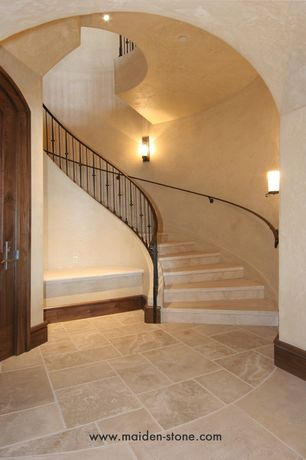 Mediterranean Staircase with Wall sconce, limestone floors, High ceiling, Spiral staircase, Loft