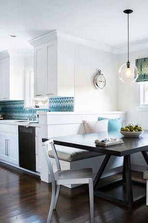 Traditional Dining Room with Crown molding, Pendant light, Hardwood floors, Window seat