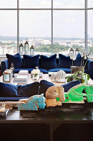 Contemporary Living Room with Folk art horse head hand puppet, Blue velvet Sofa