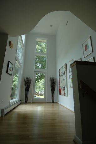 Modern Entryway with Transom window, picture window, French doors, Hardwood floors, can lights, Cathedral ceiling