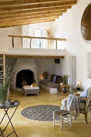Mediterranean Living Room with Fireplace, Cement fireplace, Exposed beam, Standard height, Balcony, Concrete floors
