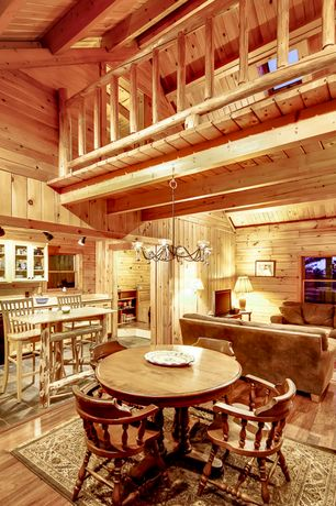 Rustic Great Room with Chandelier, double-hung window, Exposed beam, Cathedral ceiling, Pendant light, Built-in bookshelf