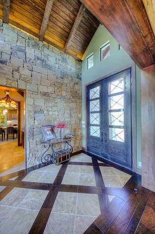 Rustic Entryway with French doors, slate tile floors, FauxPanels Carlton Ledgestone Tall Panels, Cathedral ceiling