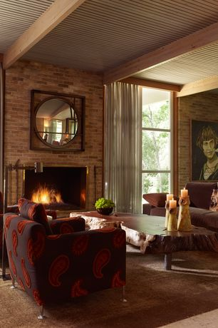 Eclectic Living Room with Standard height, brick fireplace, Exposed beam, interior brick, Fireplace, Concrete floors