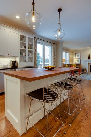 Contemporary Kitchen with Hardwood flooring, One-wall, Flat panel cabinets, Wood counters, Glass panel, Pendant light, Flush