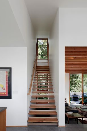 Contemporary Staircase with Floating staircase, Hardwood floors