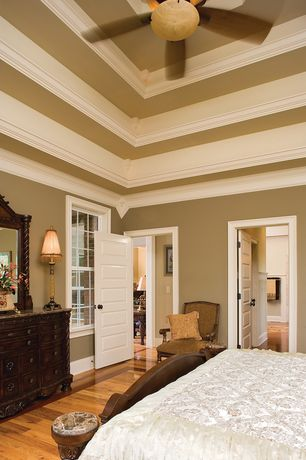 Traditional Master Bedroom with double-hung window, Hardwood floors, Box ceiling, High ceiling, six panel door, Crown molding