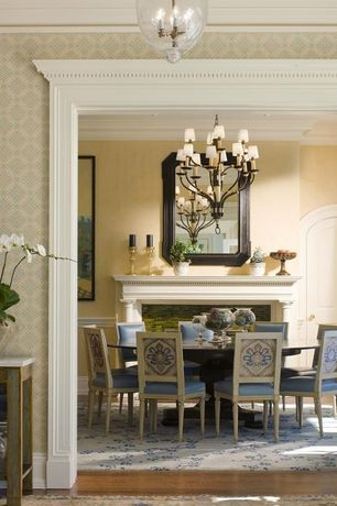 Traditional Dining Room with Crown molding, Pottery barn hundi lantern, stone fireplace, Chandelier, Hardwood floors