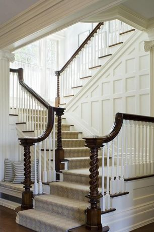 Traditional Staircase with Built-in seating, Hardwood floors, Stair carpet runner, Crown molding, High ceiling, Wood paneling