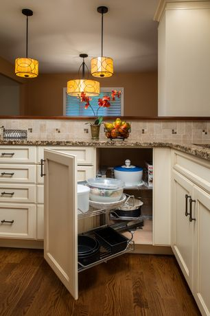 Traditional Kitchen with Undermount sink, Crown molding, full backsplash, Pull out shelves, Standard height, Limestone Tile