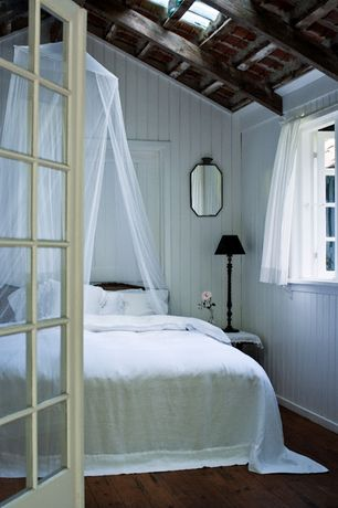 Cottage Master Bedroom with French doors, Skylight, Beadboard walls, Exposed beam, Hardwood floors