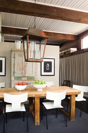 Rustic Dining Room with Exposed beam, Pendant light, Standard height, Hardwood floors, picture window