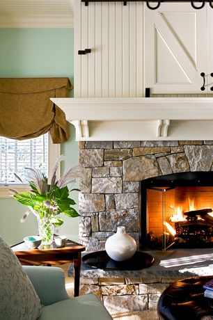 Cottage Living Room with Custom mantels, Fireplace, Paint 1, Carpet, Casement, Standard height, stone fireplace