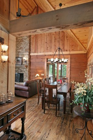 Rustic Dining Room with Hardwood floors, Casement, Built-in bookshelf, French doors, Chandelier, Wall sconce