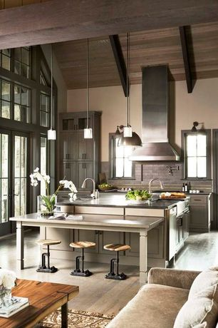 Eclectic Kitchen with Stone Tile, Soapstone counters, Wall Hood, Flush, Limestone Tile, electric cooktop, French doors