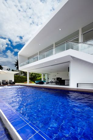 Contemporary Swimming Pool with Fence, exterior concrete tile floors, exterior tile floors, Pathway, Pool with hot tub