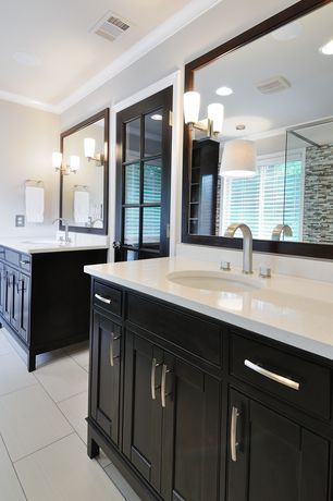 Modern Master Bathroom with Limestone, European Cabinets, Mineral tiles mosaic tile classic white brown blend, Crown molding