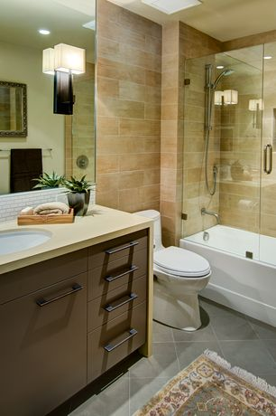 Contemporary Full Bathroom with Handheld showerhead, stone tile floors, partial backsplash, can lights, Subway Tile, Bathtub