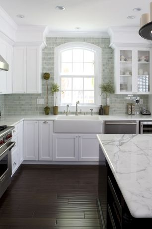 Traditional Kitchen with Andersen Curved Specialty Window, Chandelier, Farmhouse sink, Complex marble counters, Glass panel