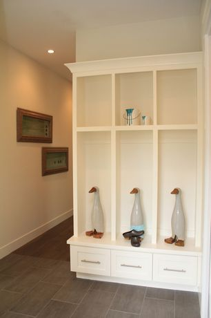 Modern Mud Room with Built-in bookshelf, Laminate floors
