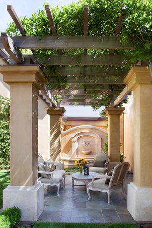 Traditional Patio with exterior stone floors, Fence, Trellis, Arbor