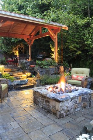 Rustic Patio with Outdoor kitchen, exterior stone floors, Fire pit, Pathway, Fence, Trellis