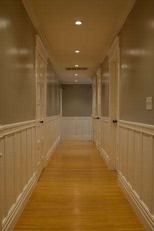Cottage Hallway with Crown molding, Wainscotting, Laminate floors