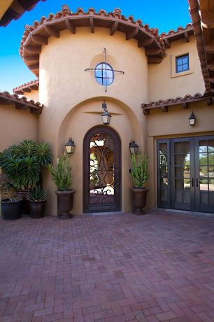 Mediterranean Front Door with Casement, French doors, exterior brick floors, specialty window
