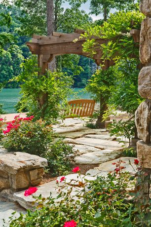 Rustic Landscape/Yard with Rock landscaping, Pathway, exterior stone floors, Porch swing, Trellis