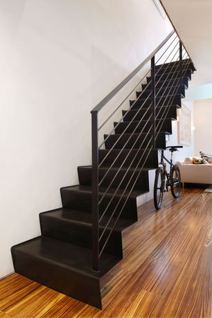 Contemporary Staircase with Laminate floors, High ceiling, Metal staircase