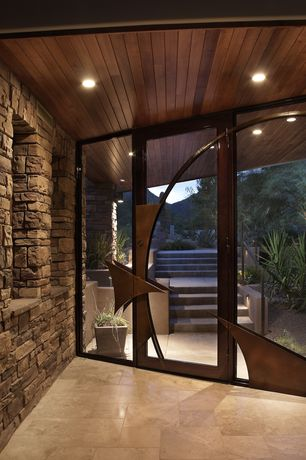 Contemporary Front Door with exterior stone floors, Arizona tile crema vosscione, French doors, specialty window