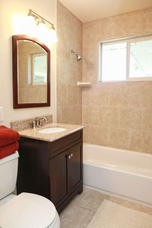 Traditional Full Bathroom with Simple granite counters, drop in bathtub, wall-mounted above mirror bathroom light, Flush