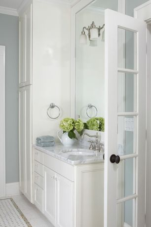 Traditional Master Bathroom with Glass panel door, Flat panel cabinets, Undermount sink, Complex Marble, Carrara white marble
