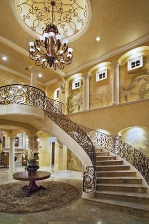Mediterranean Staircase with High ceiling, Mural, simple marble floors, Wrought iron railing, Chandelier, Columns