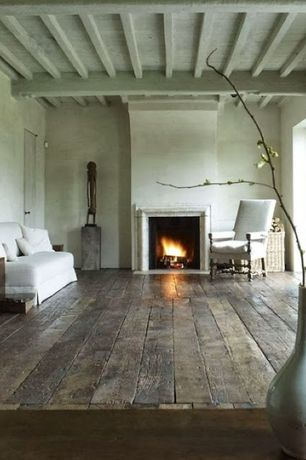 Rustic Living Room with Restoration hardware 18th c. french upholstered armchair, flat door, Exposed beam, Standard height