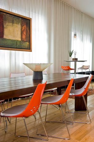 Contemporary Dining Room with Standard height, Hardwood floors, specialty window, Pendant light