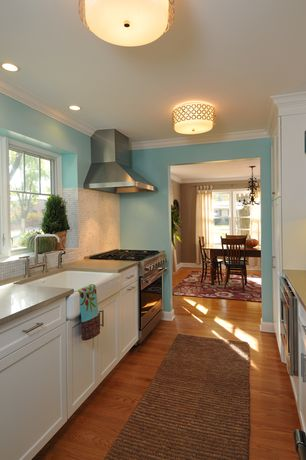 Eclectic Kitchen with Limestone Tile, Galley, Crown molding, Quartz counters, flush light, Farmhouse sink, Flush, Stone Tile