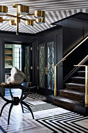 Contemporary Entryway with complex marble floors, Chandelier, Downtown Spider Table, French doors, Carpet stair runner