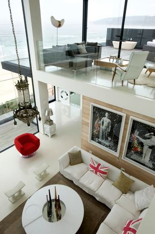 Contemporary Great Room with picture window, Bliss Upholstered Arm Chair, Chandelier, Concrete floors, Cathedral ceiling