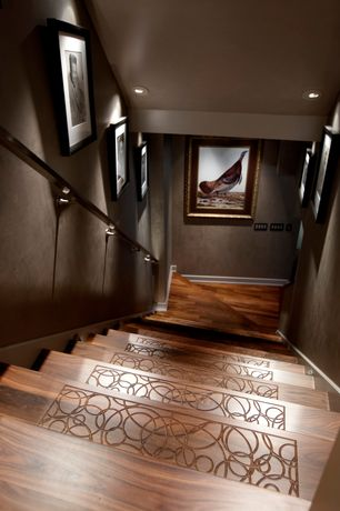 Contemporary Staircase with Hardwood floors, Standard height, can lights, curved staircase