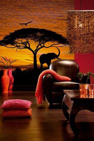 Eclectic Living Room with interior wallpaper, Curved leg coffee table by wood dekor, Chandelier, Brown leather club chair